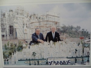 One of the images of Walt looking over the model of Small World during construction.